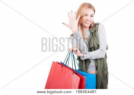 Beautiful Stylish Woman At Shopping Showing Five Fingers