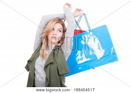 Portrait Of Pretty Young Woman With Shopping Bags