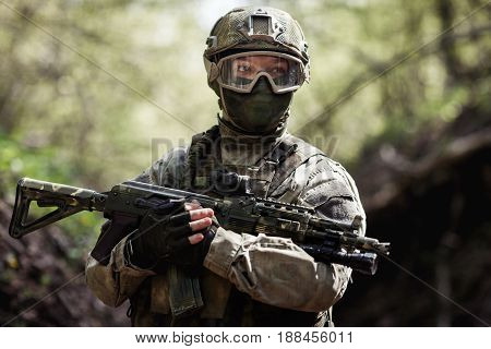 Portrait of soldier with submachine gun on military mission