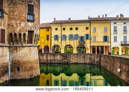 Colorful Old Houses Along The Fosse Of The Castle In Fontanellat