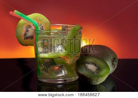 Detox with kiwi and ice on a red background with backlight