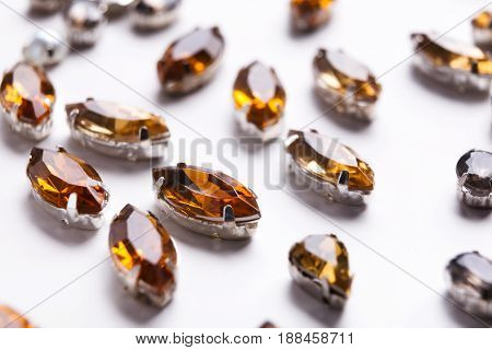 Yellow jewels on white background. Set of mounted beryl gems, jewelry production concept