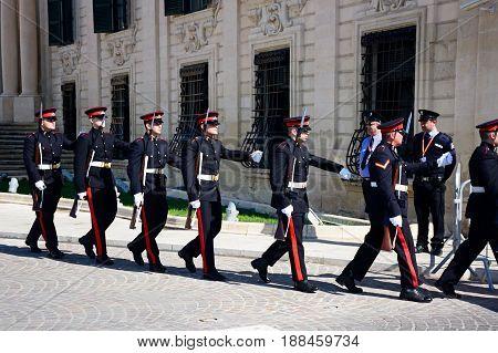 VALLETTA, MALTA - MARCH 30, 2017 - Uniformed soldiers on parade outside the Auberge de Castille for a European Union conference in Castille Square Valletta Malta Europe, March 30, 2017.