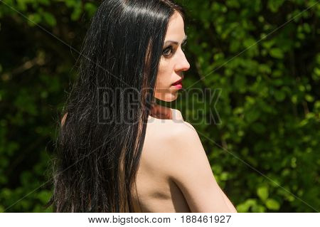 Naked half body young woman in the woods, dark mystery scene