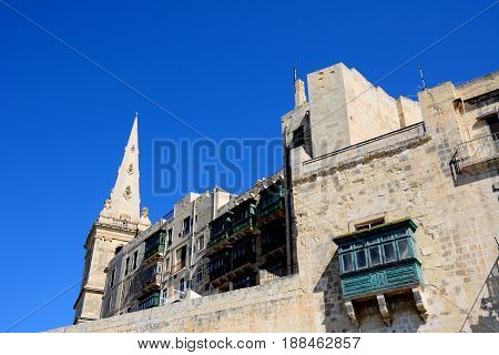 View of St Pauls Anglican Cathedral and city apartments Valletta Malta Europe.