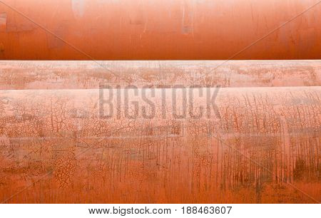 Rusty metal pipes. Corroded surfaces. Stack of pipes. Close-up.