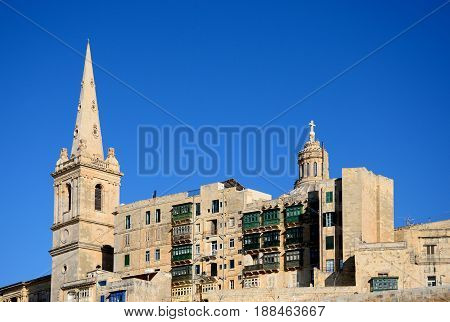 View of St Pauls Anglican Cathedral and the Basilica of Our Lady of Mount Carmel Valletta Malta Europe.