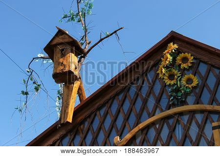 Old style birdhouse on nice wooden roof
