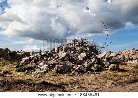 Pile of broken concrete blocks. Construction debris.