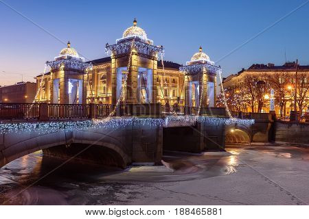 St. Petersburg Lomonosov Bridge across the Fontanka River at sunset Christmas illumination