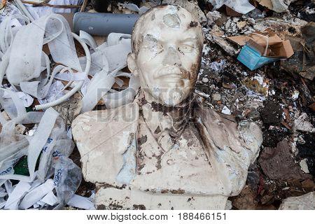 KYIV UKRAINE - FEBRUARY 28 2016: Decommunization in Ukraine. Damaged bust of Lenin in the garbage dump.