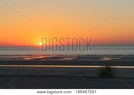 A sunset plunging into the cloudless North Sea