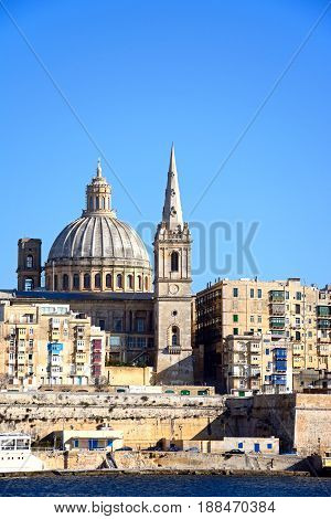 View of St Pauls Anglican Cathedral and the Basilica of Our Lady of Mount Carmel seen from the Grand Harbour Valletta Malta Europe.