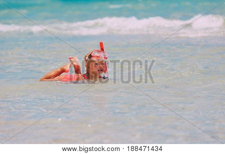 cute little girl learning to swim with diving maks, kids water sport