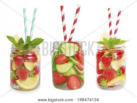 Drinks from strawberries lemons cucumbers. Collage of lemonades isolated on white background. Set of different refreshing drink with striped straw. Drinks in a glass jar.