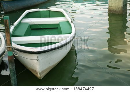 White rowboat moored near shore. - Concept boat quiet wait life hope