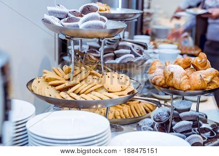 Catering table with dishes and snacks on the business event in the hotel hall. Close up, selective focus