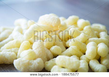 Delicious sweet corn sticks . Corn background
