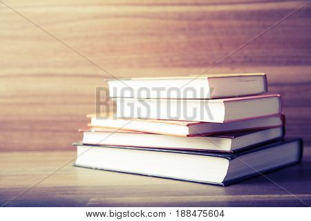 Books on wooden deck table background. Study background