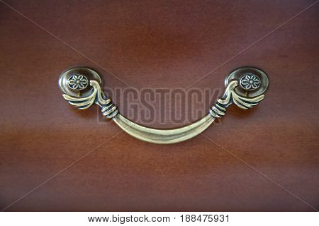 Door furniture handle and wooden door. Wood cupboard