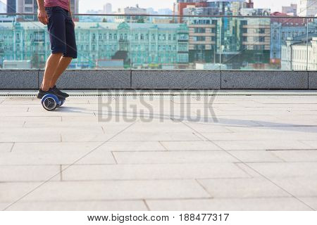 Male legs on gyroboard. Mini segway in the city. How to ride a hoverboard.