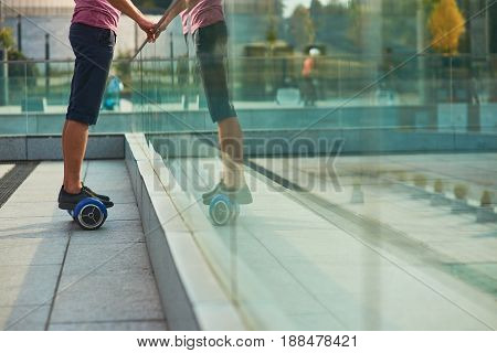 Male legs on gyroscooter. Person standing on hoverboard. Buy mini segway.