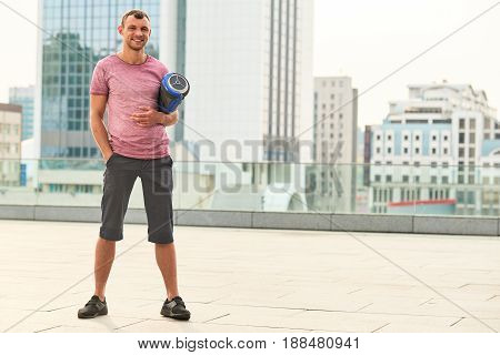 Man holding gyroboard and smiling. Happy guy on urban background. New hoverboard advertising.