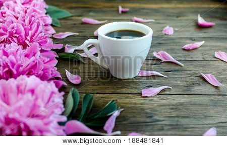 Morning Spring Coffee And Pions Flowers On A Wooden Background.