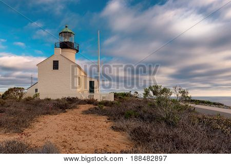 Point Loma Lighthouse at sunset in Cabrillo National Park, San Diego.