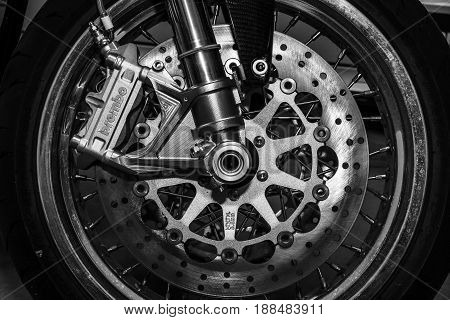 BERLIN GERMANY - MAY 17 2014: The front brakes of a sports motorcycle Norton Commando 961 Cafe Racer. Black and white. 27th Oldtimer Day Berlin - Brandenburg