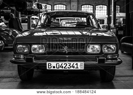 BERLIN GERMANY - MAY 17 2014: Large family car Peugeot 504. Black and white. 27th Oldtimer Day Berlin - Brandenburg