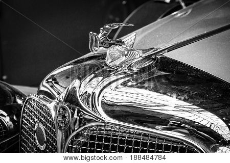 BERLIN GERMANY - MAY 17 2014: Hood ornament of the Chrysler Imperial Series CG-Eight 4-Door Dual Crawl Phaeton (1931). Black and white. 27th Oldtimer Day Berlin - Brandenburg