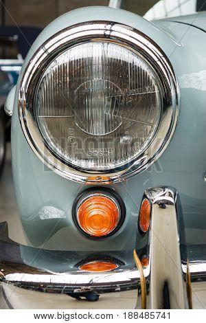 BERLIN GERMANY - MAY 17 2014: Headlamp of the Mercedes-Benz 190SL close up. 27th Oldtimer Day Berlin - Brandenburg
