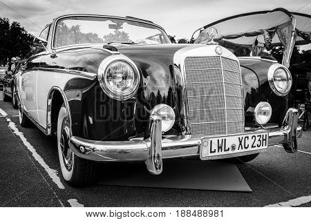 BERLIN GERMANY - MAY 17 2014: Luxury car Mercedes-Benz 220S (W180 II). Black and white. 27th Oldtimer Day Berlin - Brandenburg