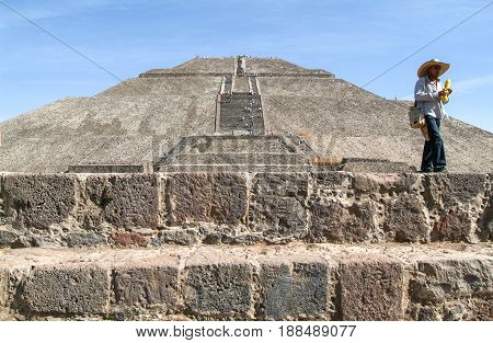 Teotihuacan Mexico - 10 january 2009: man walking in front of sun pyramid at Teotihuacan en Mexico