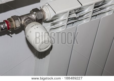 Heating white radiator with adjuster of warming