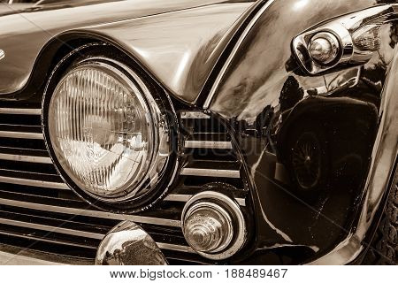 BERLIN GERMANY - MAY 17 2014: Fragment of the sports car Triumph TR5. Sepia. 27th Oldtimer Day Berlin - Brandenburg