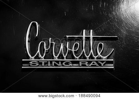 BERLIN GERMANY - MAY 17 2014: Emblem sports car Chevrolet Corvette Sting Ray (C2). Black and white. 27th Oldtimer Day Berlin - Brandenburg