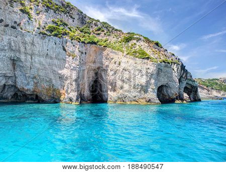 Blue Caves and blue water of Ionian sea on Island Zakynthos in Greece and sightseeing points. Boat trips tours to blue caves on Greece holidays vacations tours travels trips Best famous Greece places