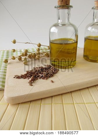Linseed oil in small bottles and linseeds