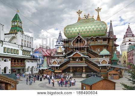 MOSCOW, MAY 26, 2017: Izmailovsky Kremlin inner yard. White stone manor. Russian traditional classic wooden and stone architecture buildings. Classic wooden empirial palace temple Russian architecture