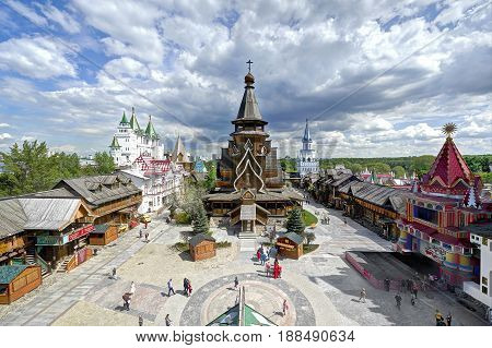 MOSCOW, MAY 26, 2017: Izmailovsky Kremlin inner yard. White stone manor Russian traditional classic architecture wooden Nikolay hierarch temple, classic towers and walls. Classic Russian architecture. European architecture