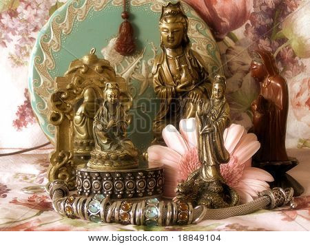 early color reproduction showing a collection of kwan yin statues