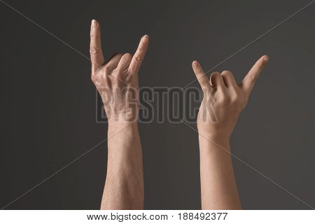 Cropped View Of Hands With Rock Signs Isolated On Grey, Young And Senior People Concept