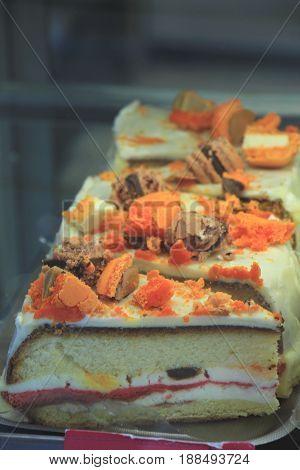 Fresh made orange chocolate cake in a shop window