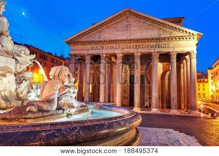 The Pantheon, former Roman temple of all gods, now a church, and Fountain at Piazza della Rotonda, at night, Rome, Italy