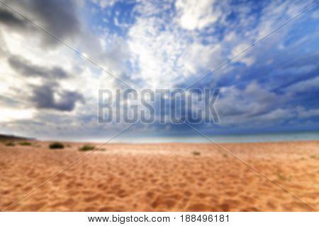 Blurred Sea Beach In Sun Summer Day