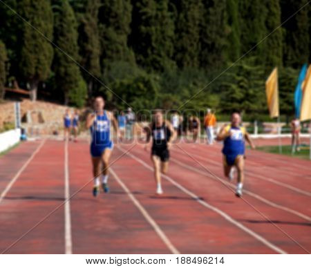 Blurred View Of Man Athletic Running Competition At Stadium