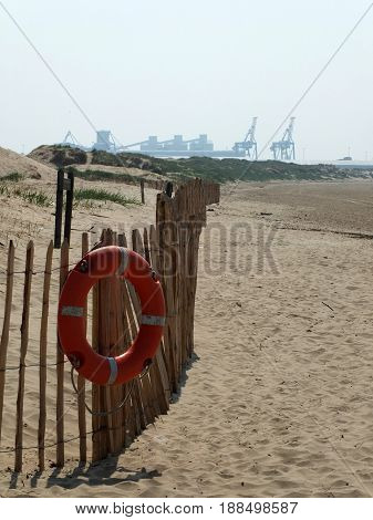 life preserver on beach in crosby near liverpool