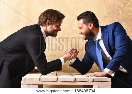 Success concept. Business partners arm wrestling in office.
